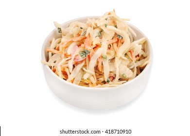Side view of  bowl filled with coleslaw isolated on  white background.