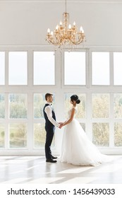 Side view of bride and fiance looking at each other