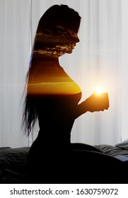 Side view brunette woman sit on bed holding coffee cup photo digitally altered combined with double exposure glowing sun picturesque sunrise cloudy sky nature landscape, good morning new day concept
