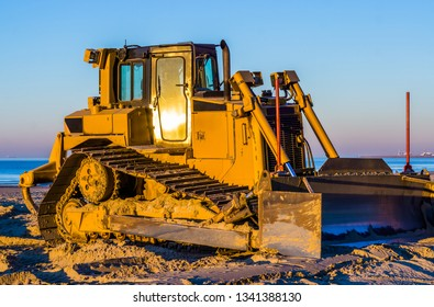 side view of a bulldozer with a scoop on the beach, ground moving machine, groundwork industry equipment