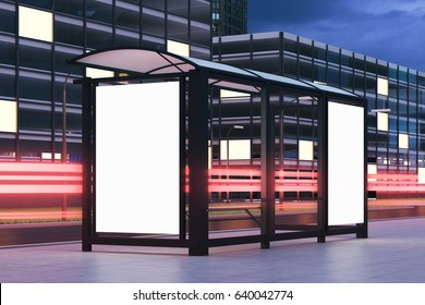 Side view of a bus stop with two blank vertical billboards standing in the night street near a building with glowing windows in the background. 3d rendering, mock up