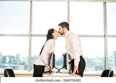 Side view of business couple Man woman kiss and type print romance message in office Pair sit on table against blue sky window background Idea concept of dating site. love letters