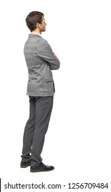 Side view of Business man  looks.  Rear view people collection.  backside view of person.  Isolated over white background.  A young guy in a suit with his hands folded listening attentively.