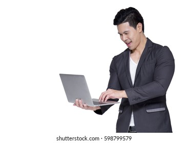 side view of a business man pointing his finger to the laptop computer