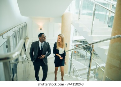 Side view of business people climbing a stair in a building on a morning. Concept of business person's routine. Toned image. Mock up