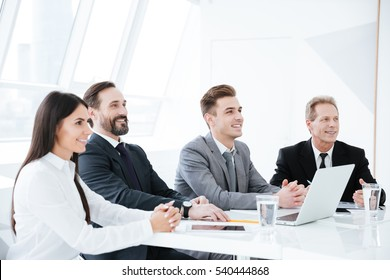 Side view of Business people sit by the table in conference room