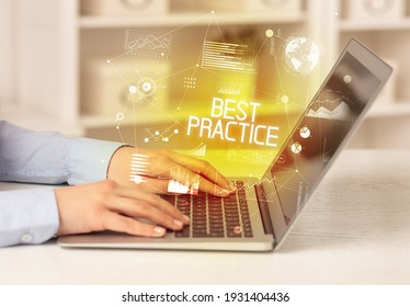 Side view of a business person working on laptop with BEST PRACTICE inscription, modern business concept