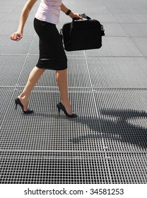 side view of business woman balancing on high heels. Copy space