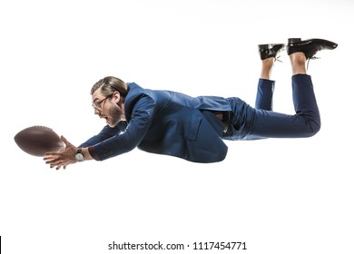 side view of businessman catching rugby ball while falling isolated on white