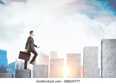 Side view of a businessman holding a suitcase and accending a giant bar chart. There is a city in the background. Toned image. Mock up.
