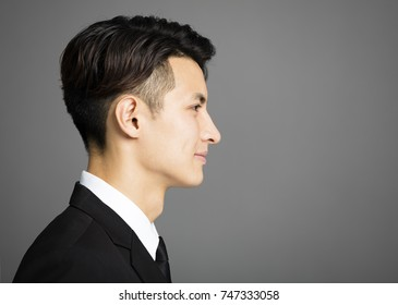 Side view of businessman isolated on gray background