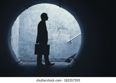 Side view of a Businessman looking in front of him in a tunnel. With room for your text