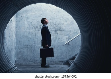 Side view of a Businessman looking up there. With room for your text.