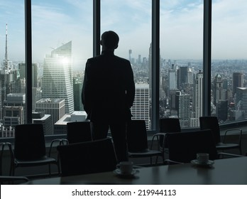 Side view of a businessman looking through window, before boardroom meeting