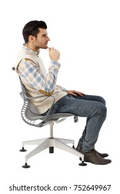 Side view of businessman sitting in swivel chair, thinking.