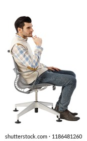 Side view of businessman thinking in swivel chair over white background.