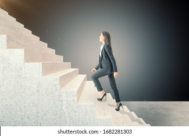 Side view of businesswoman climbing on stairs. Career development and job concept