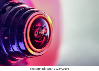 Side view of the camera with red-purple backlight. Horizontal photography