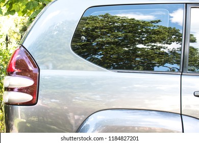 Side view of a car parked on the street in summer sunny day. Mock-up for sticker or decals.