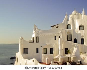 Side view of Casapueblo, a unique landmark building created by the famous artist Carlos Paez Vilaro, located near Punta del Este in Uruguay.