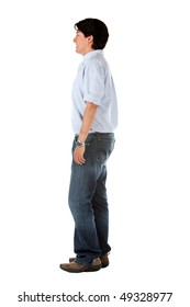 Side view of a casual man standing isolated over a white background