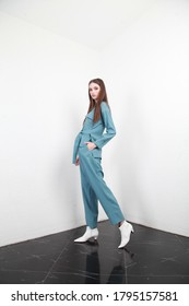 Side view of a Caucasian teenage model posing in blue summer suit in a studio with white walls background. Fashion industry campaign, catalog photosession for online store - Shutterstock ID 1795157581