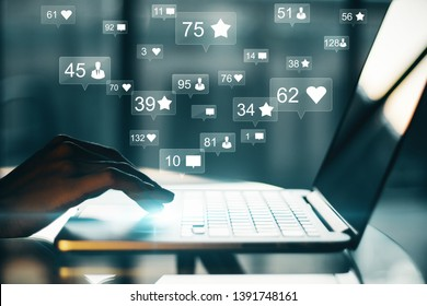 Side view and close up of hand using laptop with social media icons. Communication and network concept. Double exposure