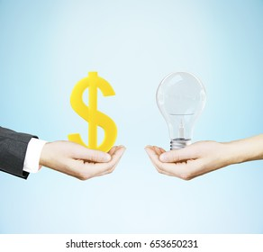 Side view and close up of hands holding dollar sign and lamp on blue background. Finance concept. 3D Rendering