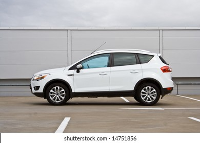 Side view of a compact SUV. Parking lot.