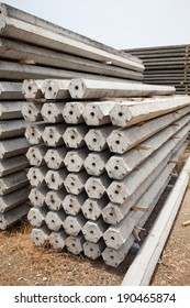 Side view of concrete electric pole piles