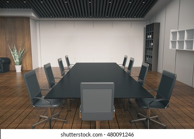 Side view of conference desk in office interior with wooden floor, concrete wall, bookshelves and other equipment. 3D Rendering