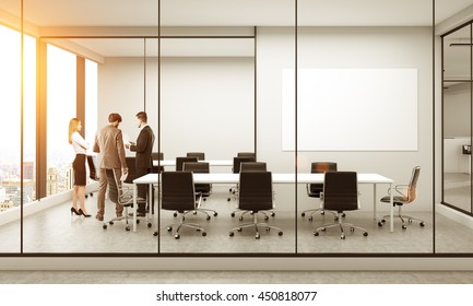 Side view of conference room interior with blank whiteboard, discussing businesspeople, furniture, city view and sunlight. Mock up, 3D Rendering