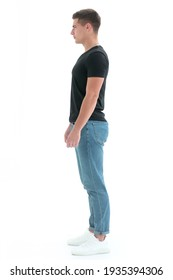 side view. confident guy in a black t-shirt .