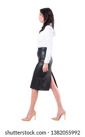 Side view of confident successful elegant business woman walking and looking ahead. Full body isolated on white background.