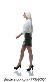 side view. Confident young business woman is moving forward.