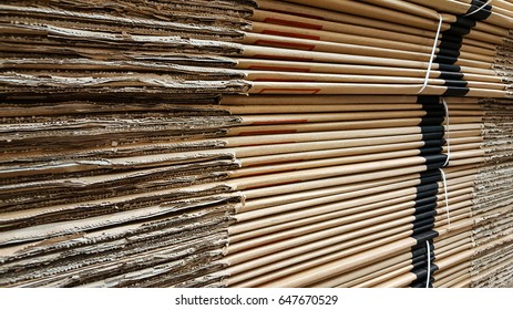 Side view of a corrugated cardboard pile in a factory