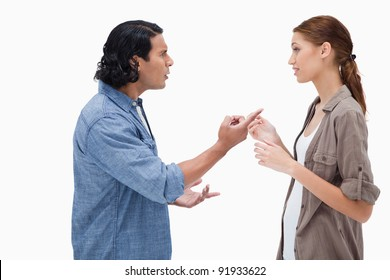 Side view of couple having a serious conversation against a white background