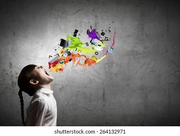 Side view of cute screaming girl and colorful splashes