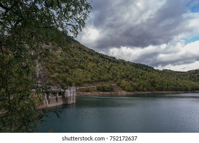 Side view of a dam under a cloudy sky