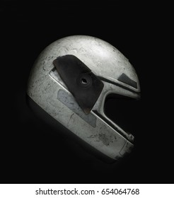 Side view of damaged helmet against black background with a cenital light. Clipping paht