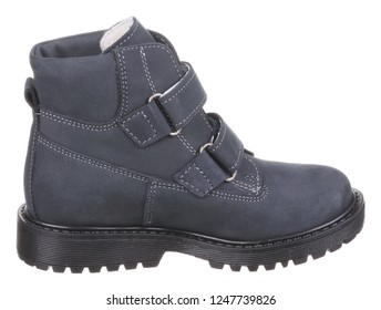Side view of dark blue and black suede water resistant winter insulated male high boot with velcro clasps and artificial fur insulation, isolated on white