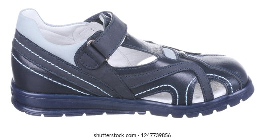 Side view of dark blue and gray leather and suede boy sandal with slits and slots, perforated insole and velcro, isolated on white