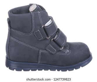 Side view of dark blue suede water resistant winter insulated male high boot with velcro clasps and artificial fur insulation, isolated on white