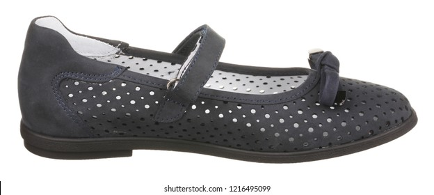 Side view of dark grey and white perforated women's suede shoe with velcro and bow, isolated on white