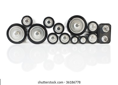 Side view of different battery types isolated over white background. With reflection.