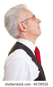 Side view of elderly businessman looking to the sky