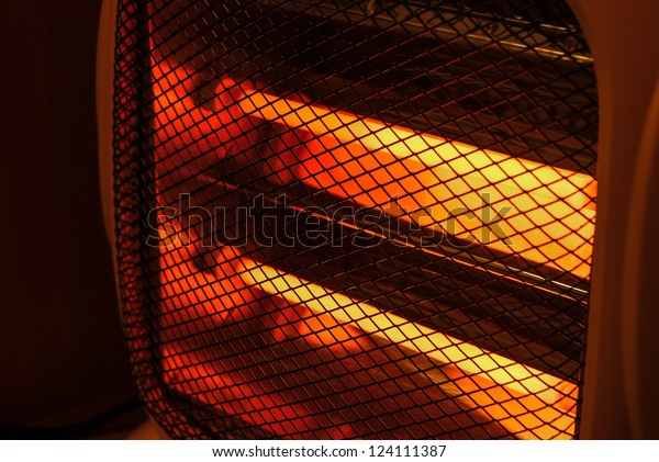 side view electric heater working in dark space