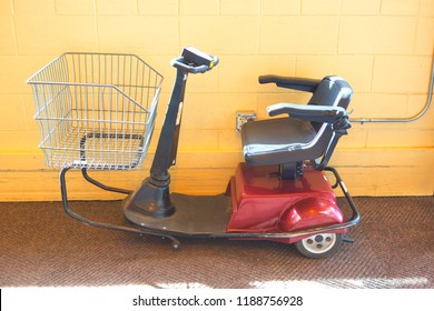 Side view of an electric scooter built for people that are unable to walk longer distances in super store.