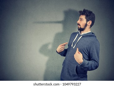 Side view of elegant man looking surprised when being caught on lie.