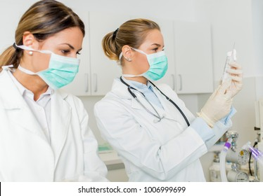 Side view at female doctors with injection